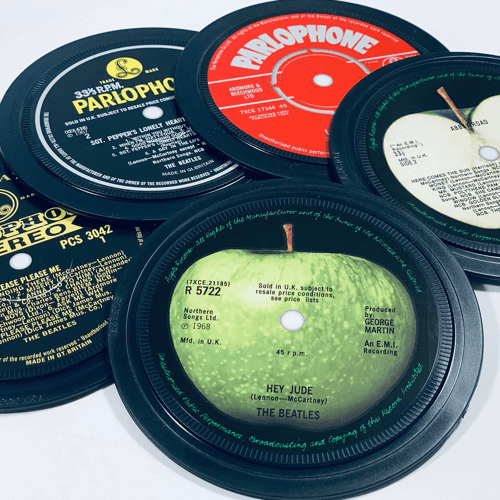 an image of original Beatles vinyl coasters - one of our favourite unusual beatles gifts