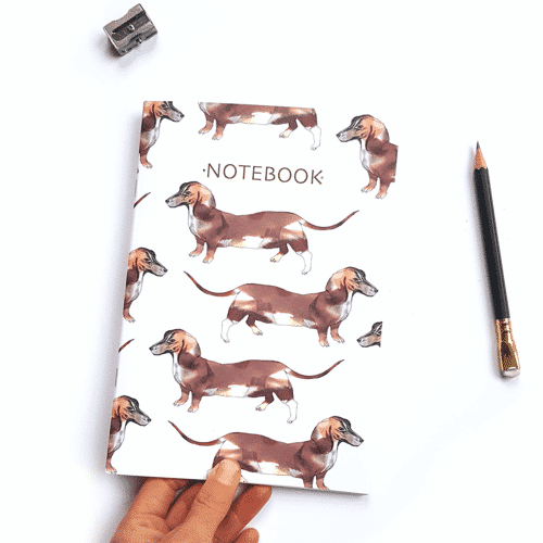 an image of a sausage dog themed notebook