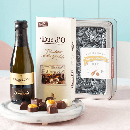 an image of an emergency chocolate and Prosecco kit ideal for new mums