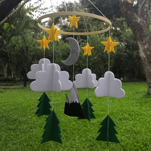 an image of a forest themed baby mobile
