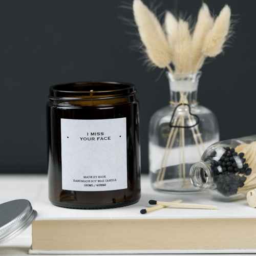 an image of a scented candle with I miss your face printed on it - one of the Taz & Jay suggestions for long distance best friend gifts