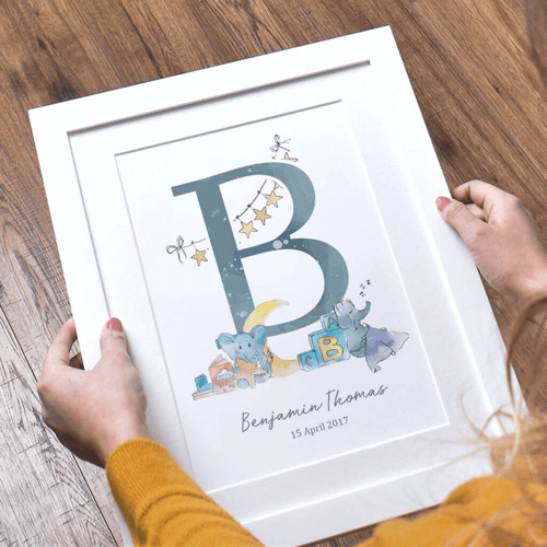 an image of a print featuring the initials of a new baby boy