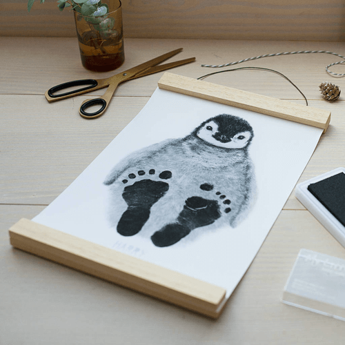 an image of a personalised baby feet penguin print