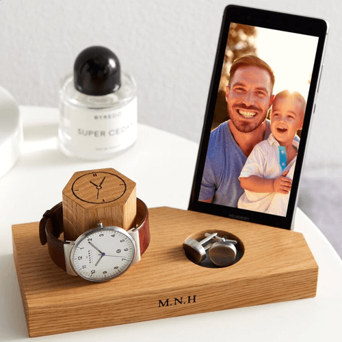 image of a personalised bedside watch and phone stand - one of our ideas for personalised anniversary gifts for him