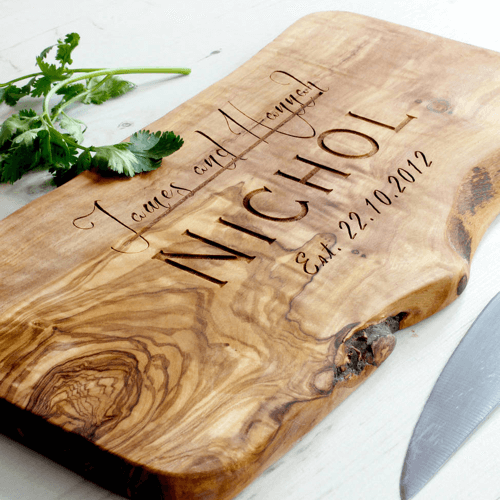 an image of a personalised olive wood chopping board and cheese board - one of our personalised mr and mrs gifts ideas