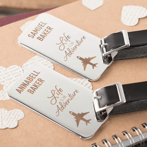 an image of personalised stainless steel luggage tags - life is an adventure