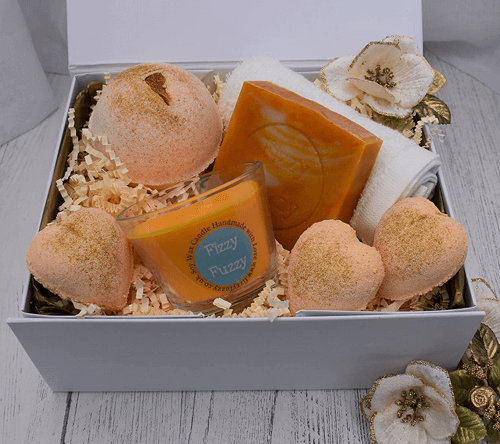 an image of a Prosecco and clementine bath bomb pamper set ideal as a best friend gift