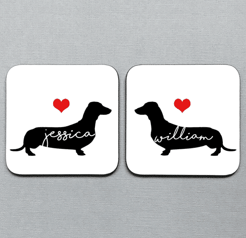 an image of a set of two personalised sausage dog coasters