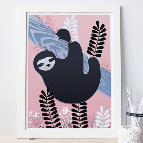 an image of a print featuring a sloth hanging in a tree - one of our suggestions for gift-worthy sloth merchandise