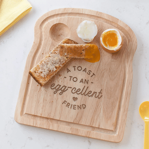 an image of a toast shaped breakfast board that is ideal as a best friend gift