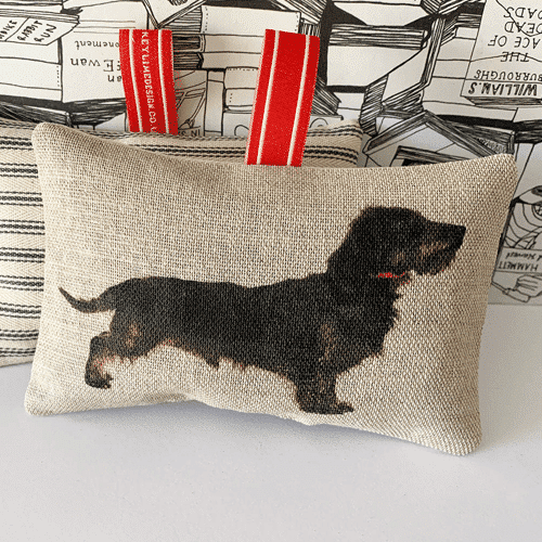 an image of a sausage dog themed lavender bag