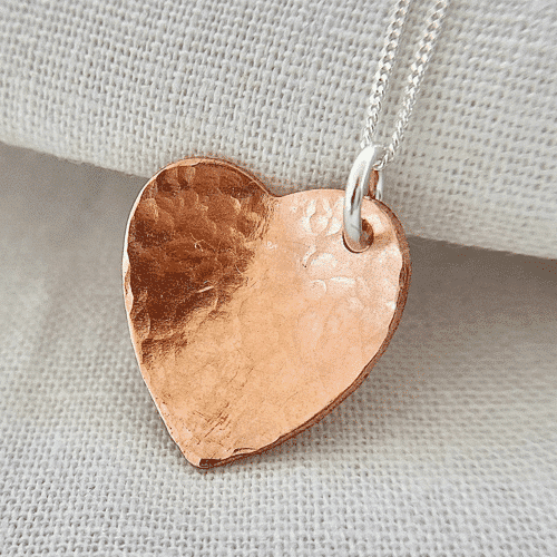 an image of a copper heart necklace