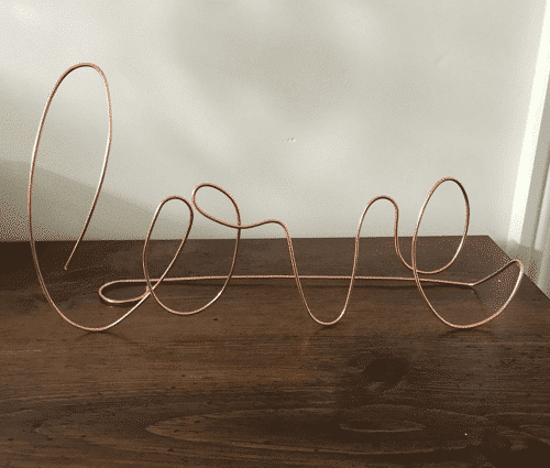 an image of a handmade copper love sign