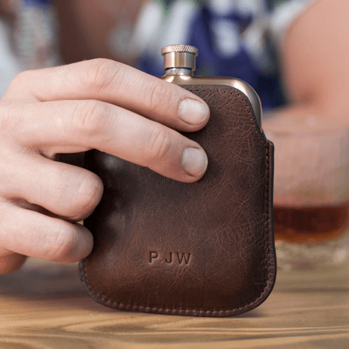 an image of a personalised copper hip flask