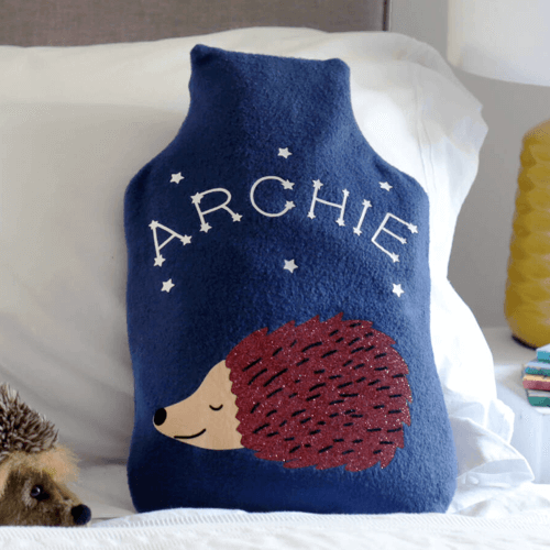 an image of a personalised hedgehog hot water bottle cover