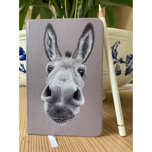 an image of a cute donkey notebook - one of our choices of donkey related gifts