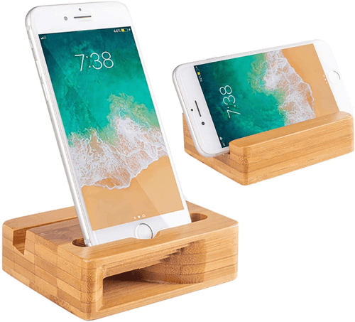 an image of a natural bamboo phone stand with sound amplifier - one of our ideas of great gifts for a 17 year old boy