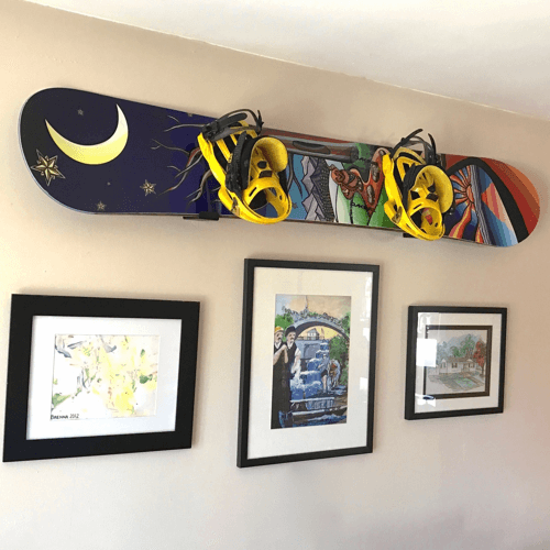 an image of a snowboard display wall rack - one of our ideas of gifts for snowboarders