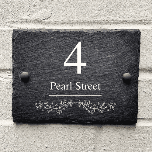an image of a custom slate house sign - one of our ideas for personalised housewarming gifts