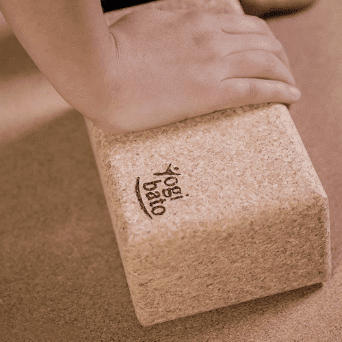 an image of a natural cork yoga block - one of our ideas of yoga lover gifts