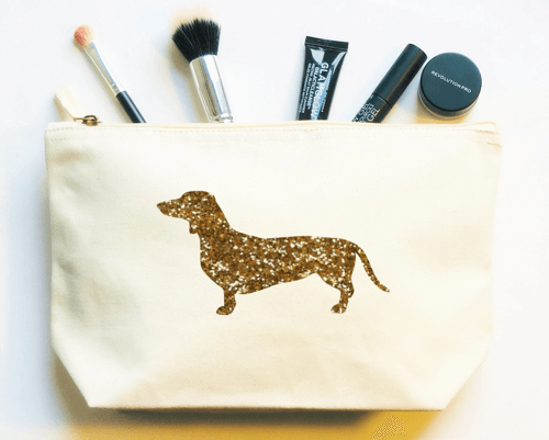 an image of a sausage dog make up toiletry wash bag - one of our favourite dachshund gifts for her