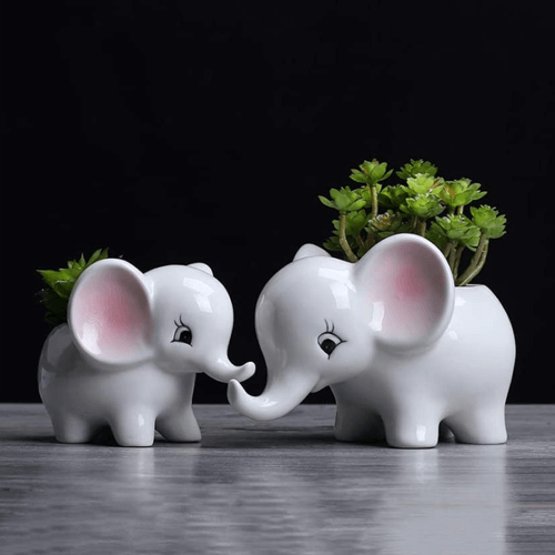 an image of animal themed plant pots